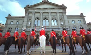 Mounted guards in front of the House of Parliament in Bern, Switzerland.