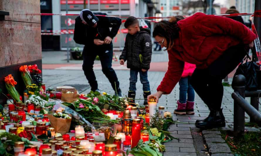 People leave candles and flowers outside one of the shisha clubs targeted by the Hanau gunman