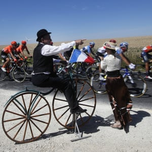 A spectator dressed as cyclist from the olden days watch the pack riding during the fourth stage between Reims and Nancy.