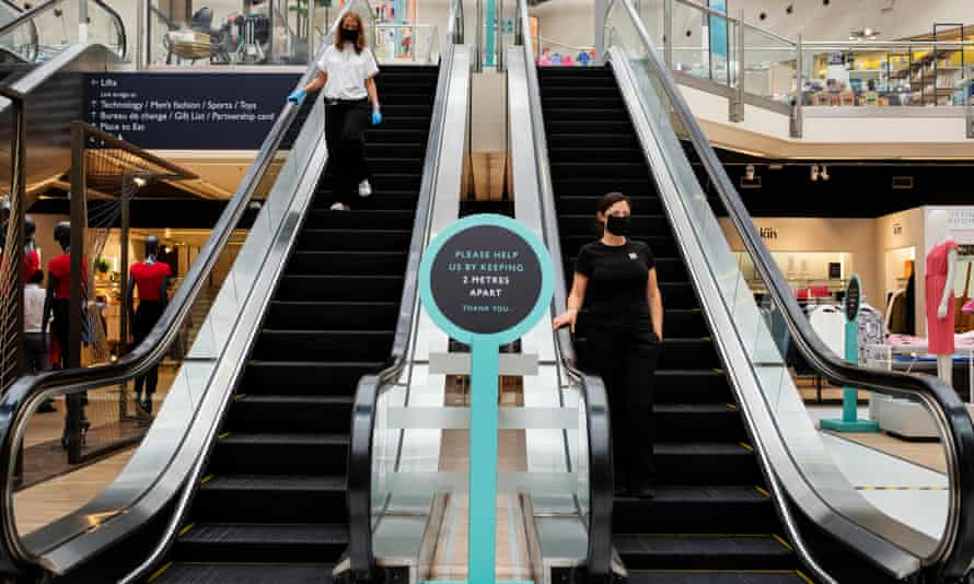 John Lewis escalator and keep your distance sign