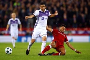 Liverpool's Alex Oxlade-Chamberlain slides in to dispossess Maribor's Marwan Kabha.