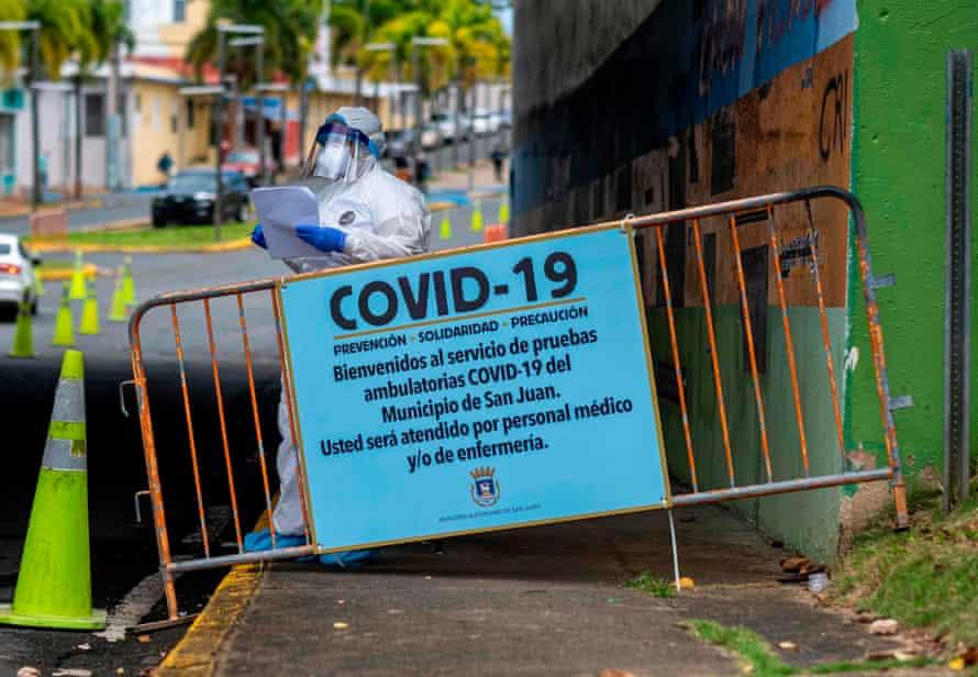 A drive-through testing site in San Juan