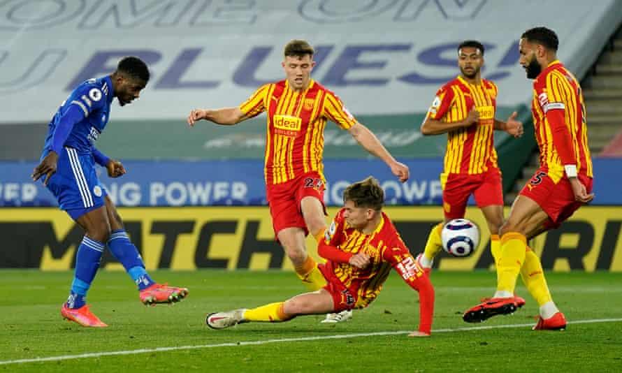 Kelechi Iheanacho celebrates Leicester's third goal against West Brom.