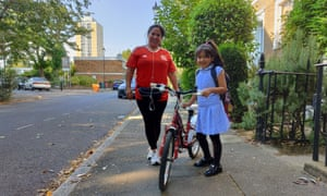 Jaquelin Gutierrez with daughter Lauren, making the most of a car-free school run.
