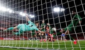 Athletic Bilbao's goalkeeper Unai Simón and Inaki Williams clear the ball from the goalline