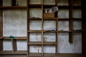 Bookshelves at a primary school in Montserrado county lie empty apart from a few papers, some green twine and a handbell. The government is pinning its hopes of improving education provision on a controversial scheme to privatise all Liberia's schools.