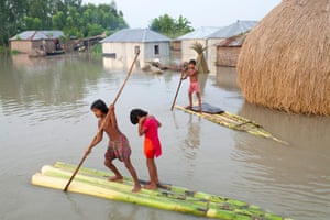 Children paddle rafts through the streets in Kurigram District, Bangladesh, September 2015.