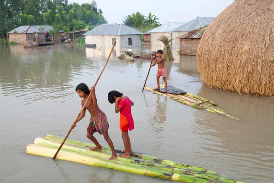 Children paddle rafts through the streets in Kurigram District, Bangladesh, September 2015.
