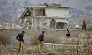 Policemen guard the compound in Abbottabad where Osama bin Laden was killed by US special forces.