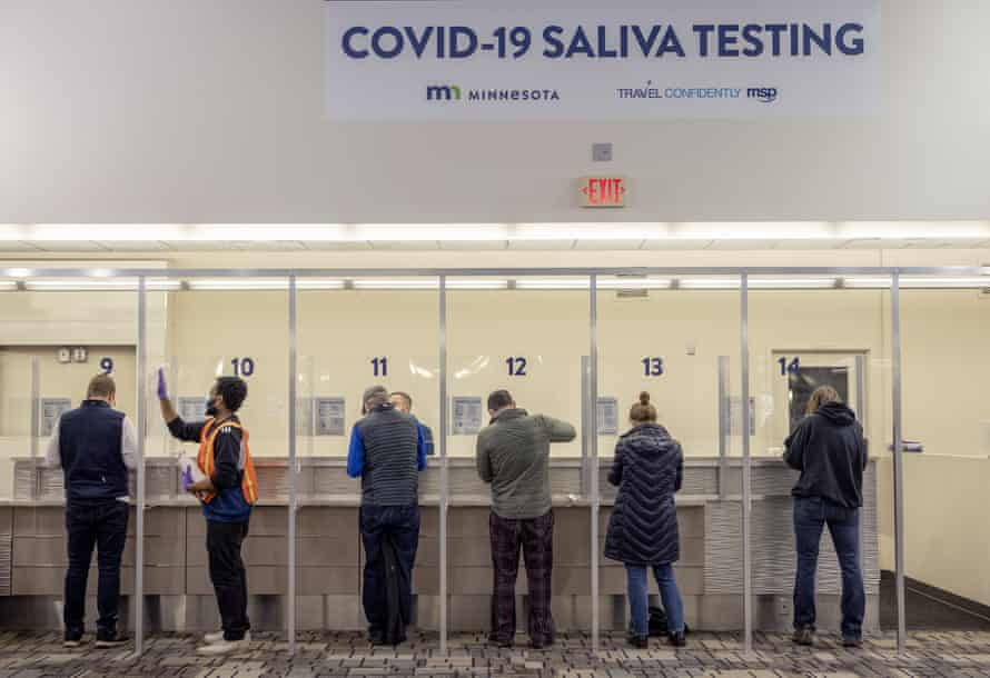 People get tested at the new saliva Covid-19 testing site at the Minneapolis-St Paul international airport.