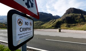 A sign at Glencoe tells people to stay at home and not camp. The Scottish tourism sector is to reopen on 15 July.