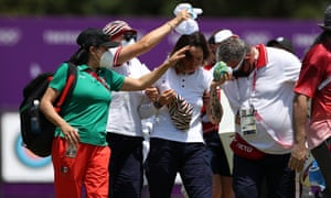 People help Russian archer Svetlena Gombaeva after she felt faint in the heat as temperatures soared at the Olympics