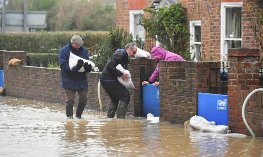 Residents of Tewkesbury, Gloucestershire stack sandbags in the aftermath of Storm Dennis, expecting more rain