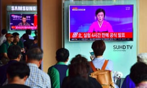 People watch a North Korean television news broadcast announcing the country's latest nuclear test at a railway station in Seoul, 9 September 2016.