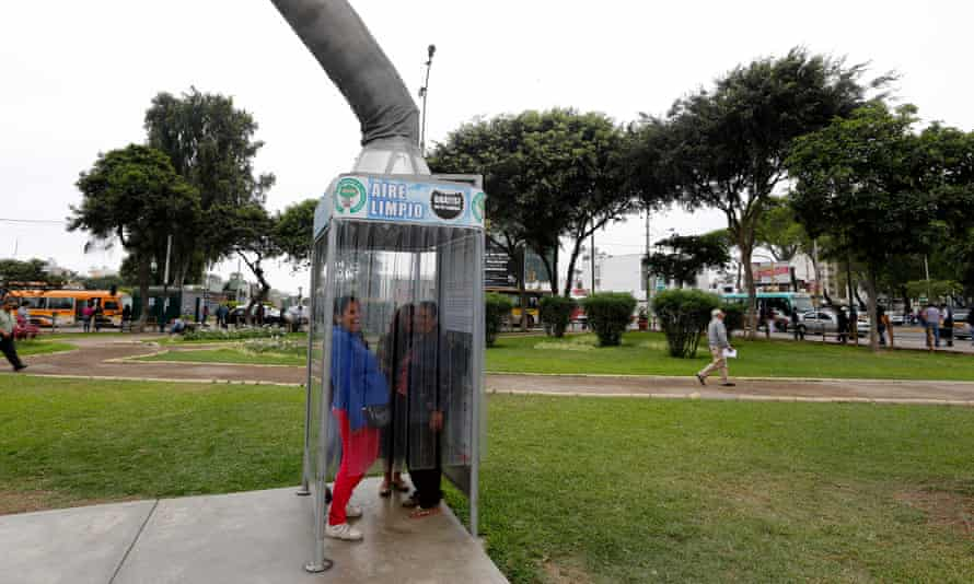 People breathe fresh air from a giant air purifier in Lima