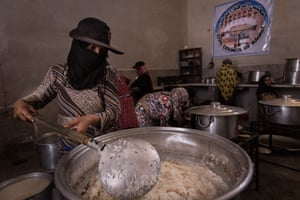 Inside the camp, women from Raqqa prepare food for the residents