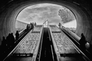 Passengers travel in to and out of the abyss at Dupont Circle metro station in Washington DC.
