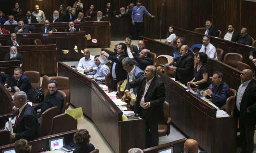 In a Knesset session, Arab MKs protest against the recent legislation that defines Israel as the nation-state of the Jewish people.