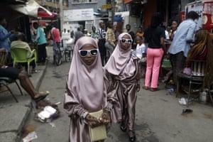 Lagos, Nigeria. Muslim girls walk down a street after prayers