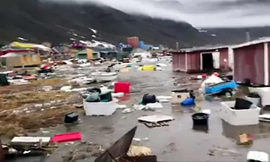 A screen image of video shows houses close to Nuugaatsiag, Greenland, flooded by waves likely caused by an earthquake.