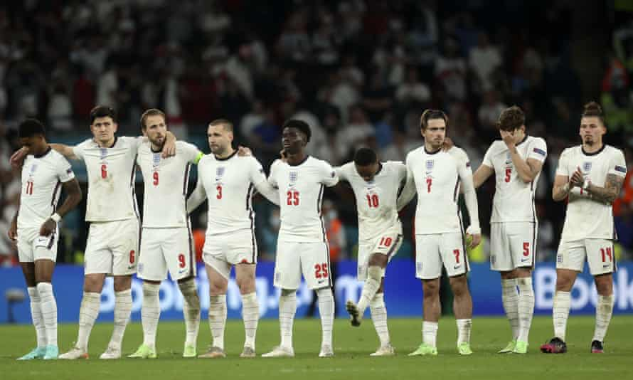 England players react during the penalty shootout at the Euro 2020 final between England and Italy at Wembley stadium in London, Sunday, July 11, 2021.