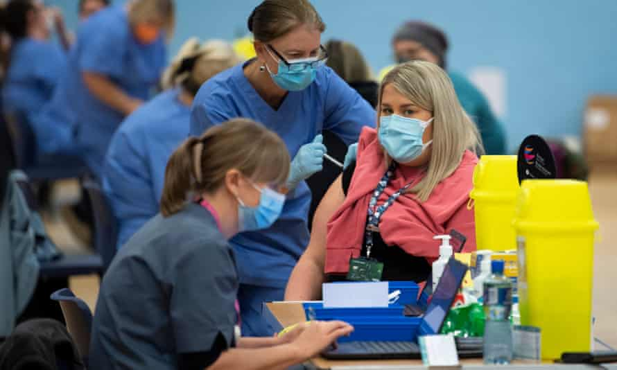 A woman receiving the Pfizer/BioNTech vaccine at Cwmbran Stadium in Wales.