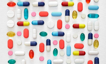 Pills and capsules against a white background