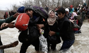 Migrants attempt to pass the border between Greece and Macedonia.
