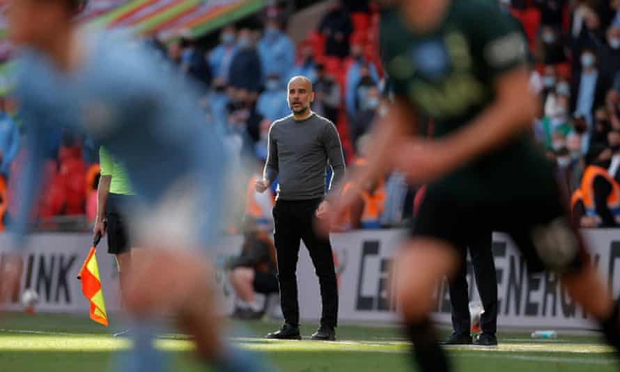 Pep Guardiola watches on during Manchester City's win against Tottenham in the Carabao Cup final last Sunday.