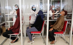 Jakarta, Indonesia. Healthcare workers perform Covid swab tests on train passengers ahead of Eid al-Fitr holidays at Pasar Senen station. The government is prohibiting people from carrying out Eid homecoming activities this year to try to curb the spread of the disease