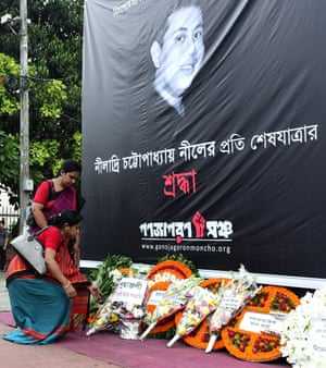 Women place a floral wreath during a protest against the killing of Niladry Chattopadhya in August 2015
