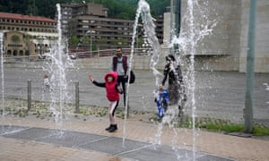 A girl plays in a fountain at the Guggenheim Museum in Bibao after restrictions were partially lifted for children for the first time in six weeks