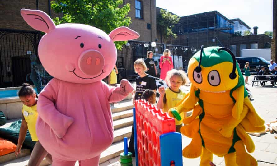 Children from Newham play with characters at the launch of M&S's new Community Transformation Programme, at Stratford Old Town Hall in east London