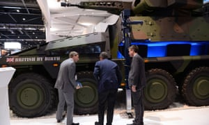 Visitors inspect a British-built armoured vehicle at the Defence Systems and Equipment International arms fair
