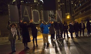 Protesters engage with Chicago police after the release of the 2014 video of Laquan McDonald being shot by Jason Van Dyke.