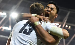 Henry Slade of England celebrates with Manu Tuilagi after scoring his side's third try in Dublin.