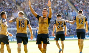 Arsenal's Alexis Sánchez celebrates after completing his hat-trick at Leicester.