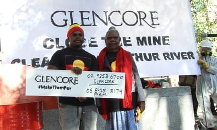 Protesters from the Northern Territory's Borroloola Indigenous clan groups demand Glencore close and clean up its McArthur River Mine site in the Top End