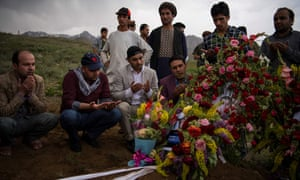Friends and relatives at the funeral of Shah Marai, AFP's chief photographer in Afghanistan, who was killed by the second of two bombings in Kabul on.
