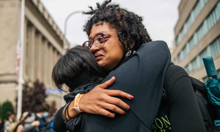 Demonstrators react to the grand jury verdict in the Breonna Taylor killing on 23 September.