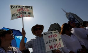 Demonstrators hold placards during a protest in Monterrey, Mexico, against Trump's proposed border wall.