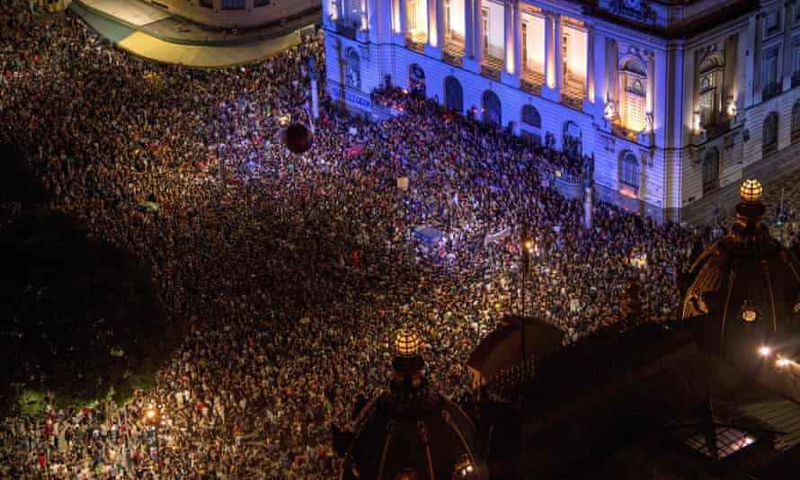 Protesters over Franco's killing outside Rio's municipal chamber on Thursday