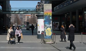 People stroll outside a Berlin shopping mall on the day German leaders decide to extend a partial lockdown.