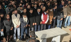 Hundreds of people gather to perform funeral prayers in absentia at the Fatih mosque in Istanbul on Friday