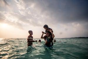 Kids play in the ocean on Pasir Panjang beach, Kei Kecil.
