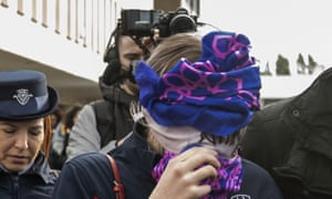 The teenager covers her face as she arrives at Famagusta district court, Cyprus.