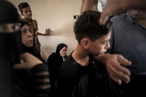 Relatives of Palestinian boy Omar Hassan Abu al-Nile, 12, who was shot on during a violent demonstration near the border fence separating the Gaza Strip from Israel, mourn his death. About 100 people attended his funeral.