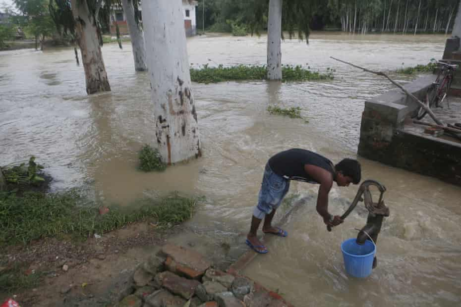A boy tries to collect drinking water in Janakpur, Nepal