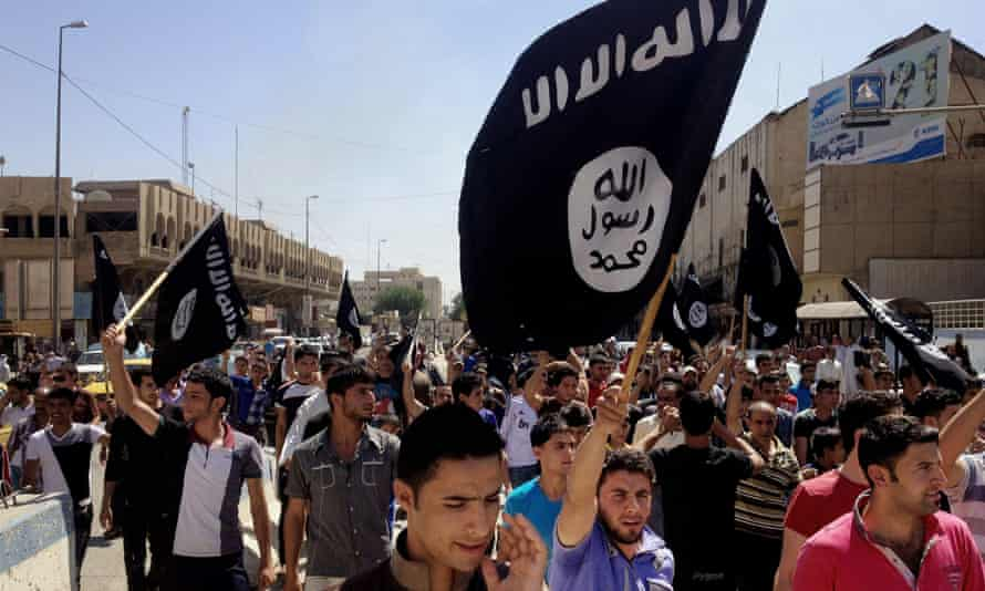 Pro-Islamic State demonstrators rally in front of the provincial government headquarters in Mosul, Iraq, in June 2014. The Iraqi army collapsed when confronted by Isis in Mosul last year.