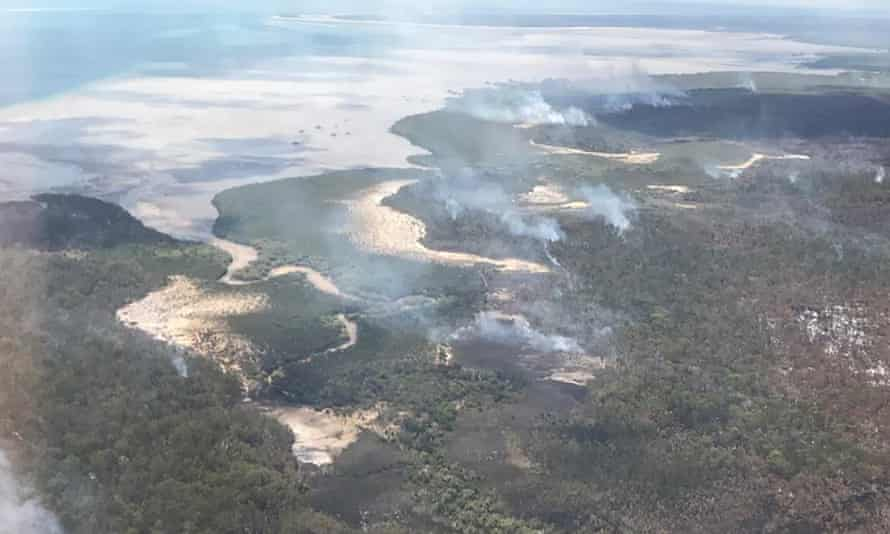 Smoke from bushfires along the coast of K'gari, also known as Fraser Island, off the Queensland coast.